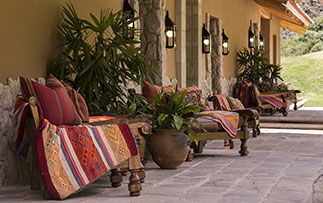 South America Peru Sacred Valley Inkaterra Hacienda Urubamba relaxing patio colorful decor - luxury vacation destinations