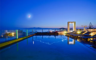 Europe Greece Agios Prokopios Naxos Island Hotel outdoor pool at night with moonlight - luxury vacation destinations