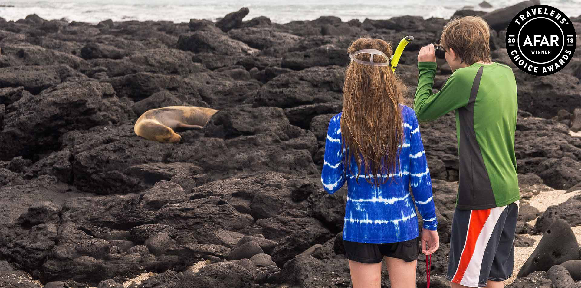 Children Looking at Seals, Galapagos Islands