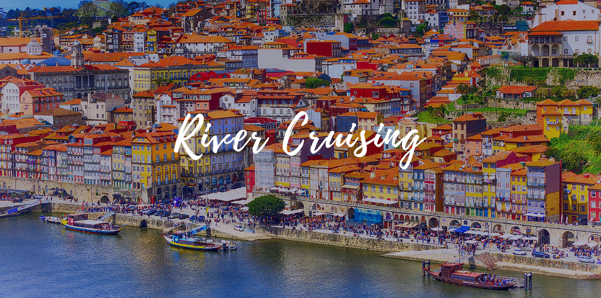 Europe Douro river cruising beautiful colorful homes overlooking river-bridge-luxury vacation destinations