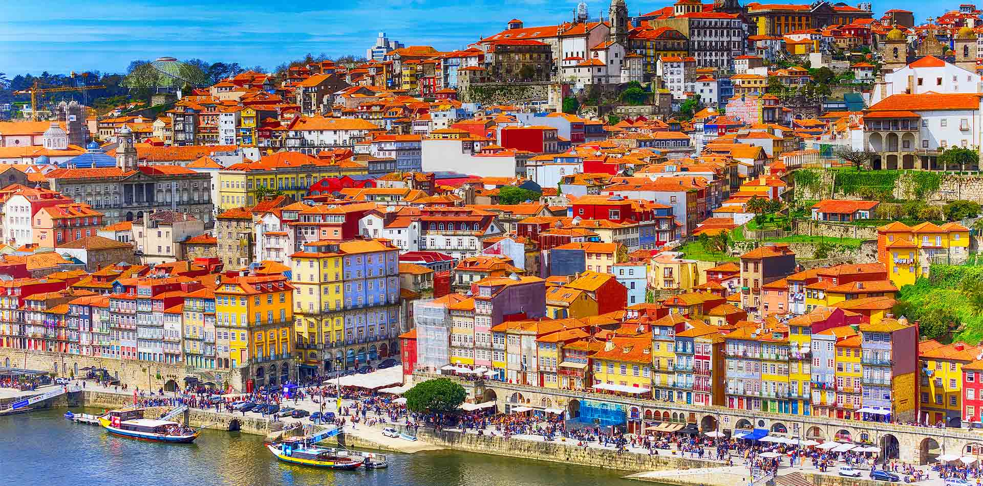 Europe Portugal Douro River Ribeira aerial view of promenade with colorful houses and boats - luxury vacation destinations