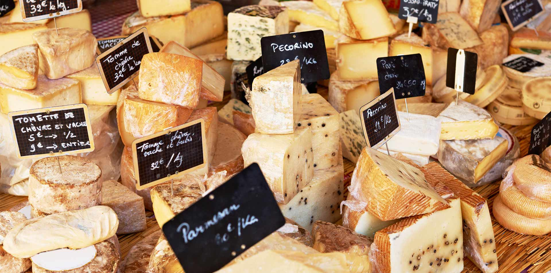 Europe France Provence assortment of french cheese in local market chevre pecorino parmesan - luxury vacation destinations