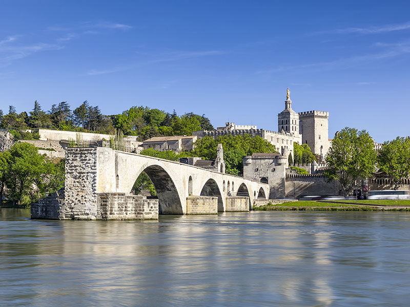 Europe France Avignon river cruising beautiful stone bridge and buildings -luxury vacation destinations