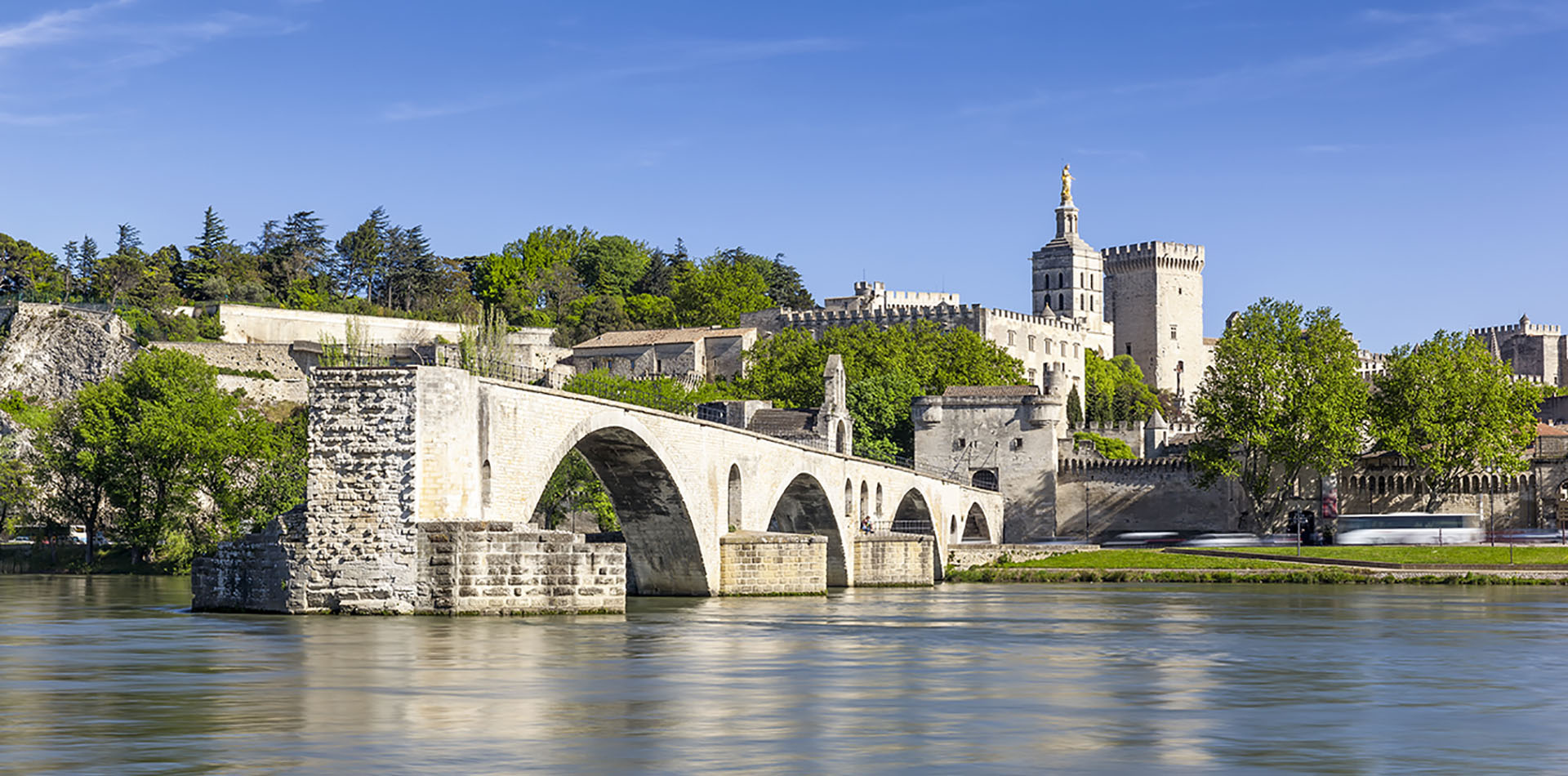 Europe France Avignon beautiful stone buildings and bridge view of the river and a castle - luxury vacation destinations
