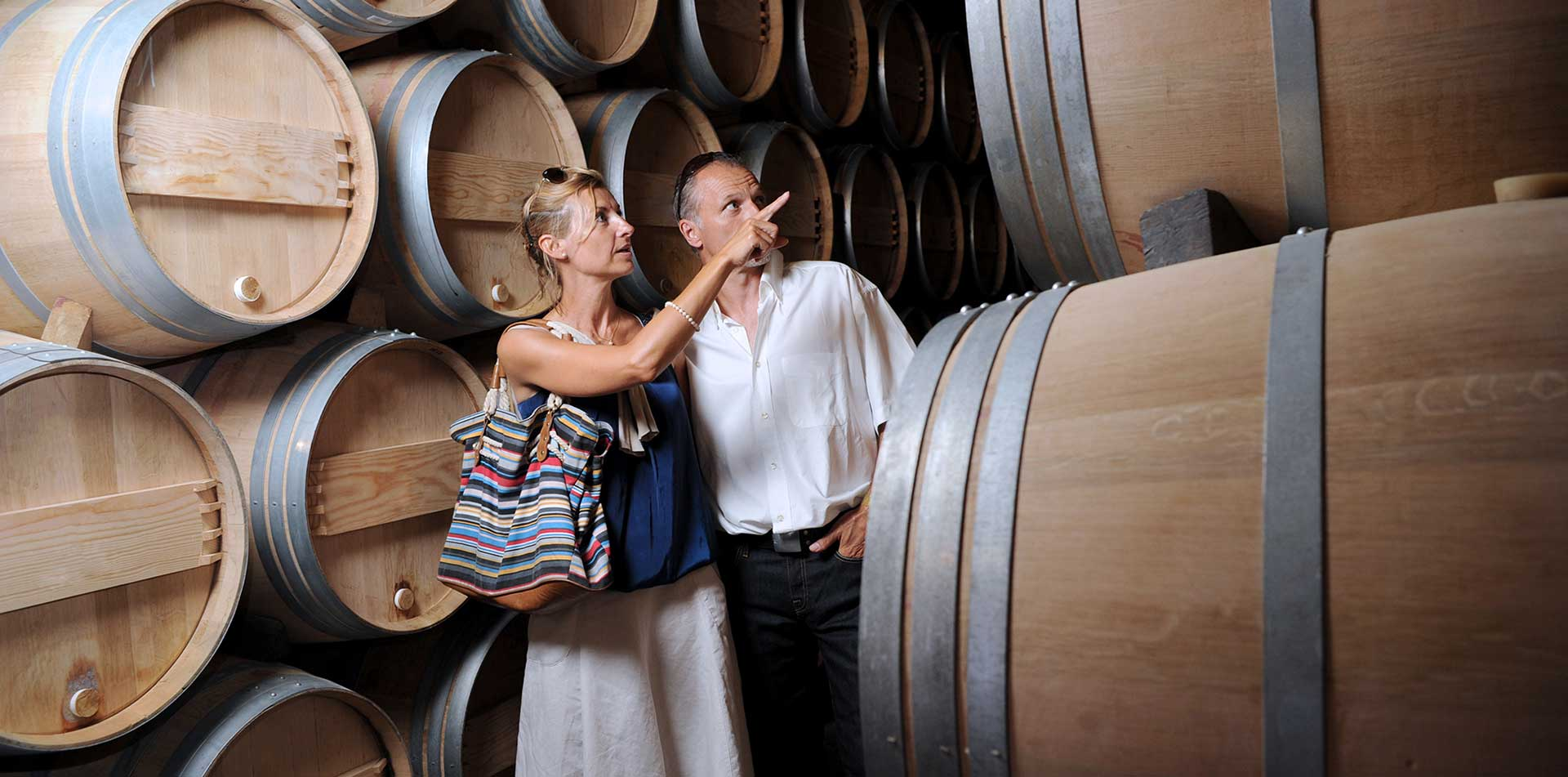 Europe Portugal Spain Douro river cruising guests enjoy looking at wine barrels- luxury vacation destinations