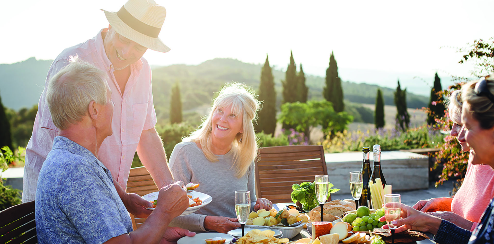 Europe Italy Tuscany alfresco lunch happy travelers eating food wine tour - luxury vacation destinations