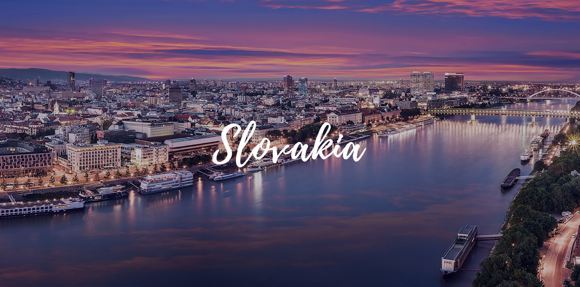 Europe Danube river cruising beautiful view of evening lights on the river in the capital city of Slovakia -luxury vacation destinations