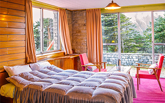 Asia Nepal Sagarmatha National Park Hotel Everest View rustic colorful cozy accommodations - luxury vacation destinations