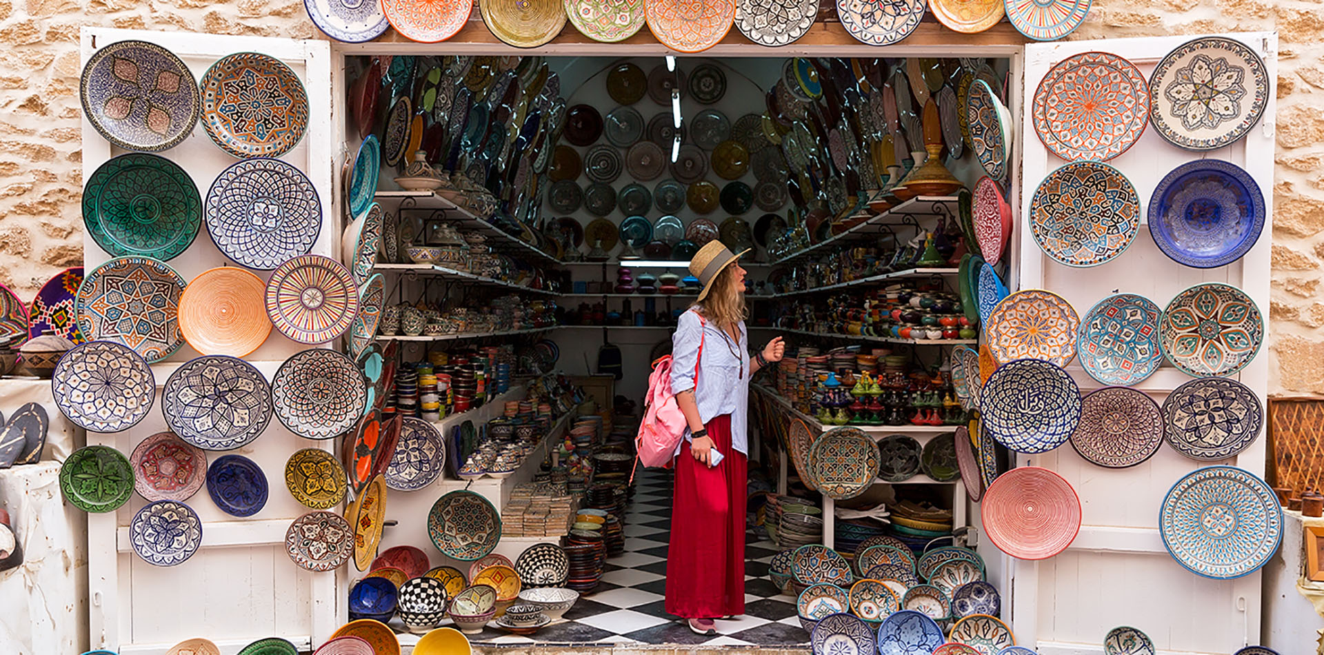 Woman standing in store in Morocco looking at Plates