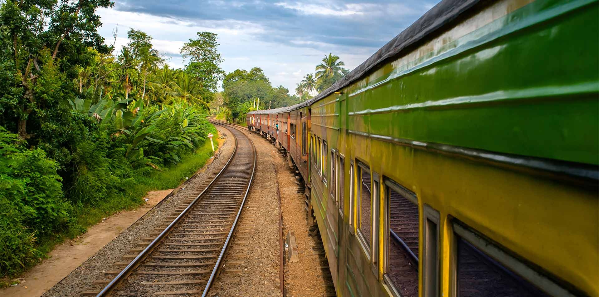 Asia India colorful train going through rural India countryside - luxury vacation destinations