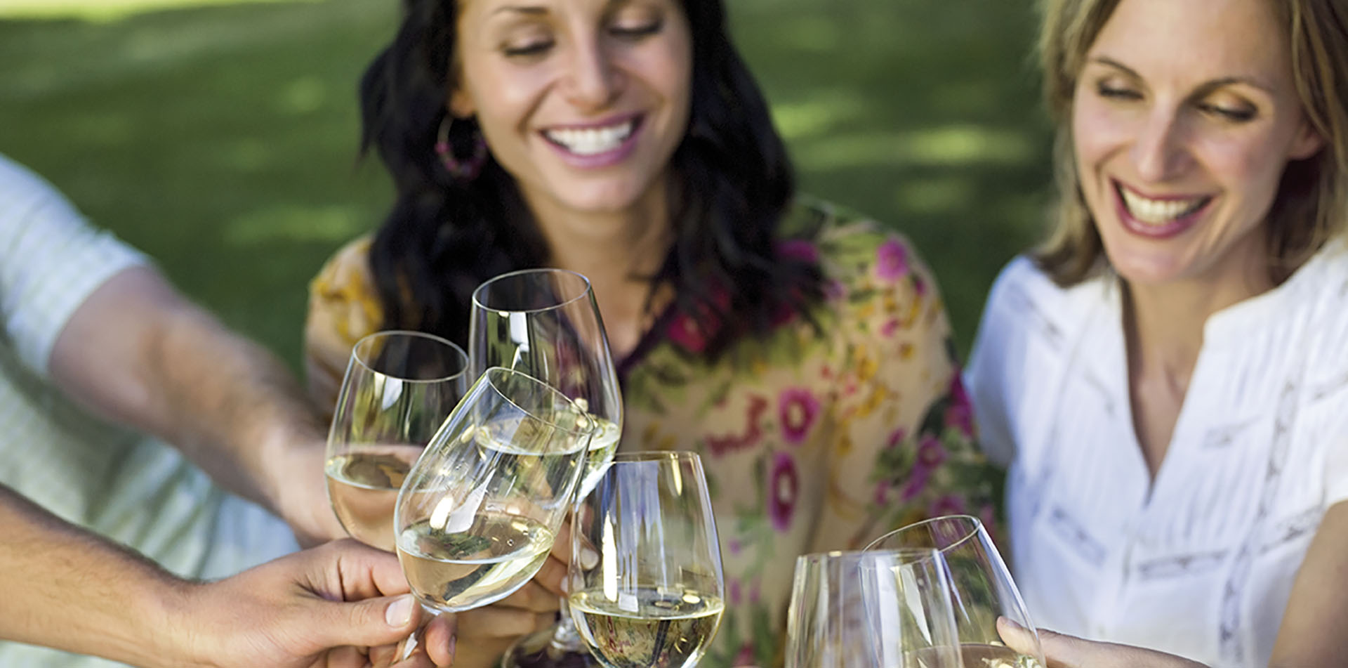 Traveling friends toasting with glasses of white wine international day of friendship - luxury vacation destinations