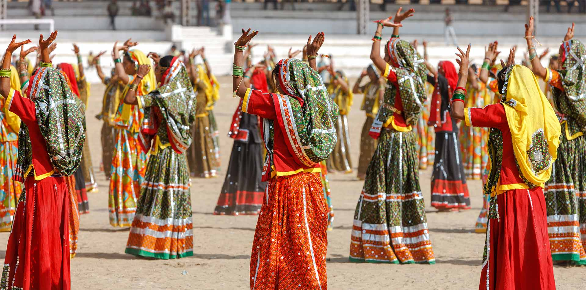 Asia India Rajasthan Pushkar people dancing in traditional clothes - luxury vacation destinations