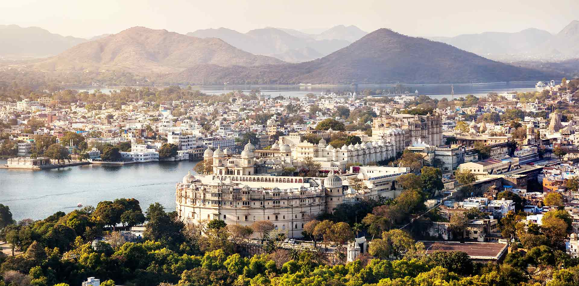 Asia India Lake Pichola with view of city palace in Udaipur Rajasthan - luxury vacation destinations