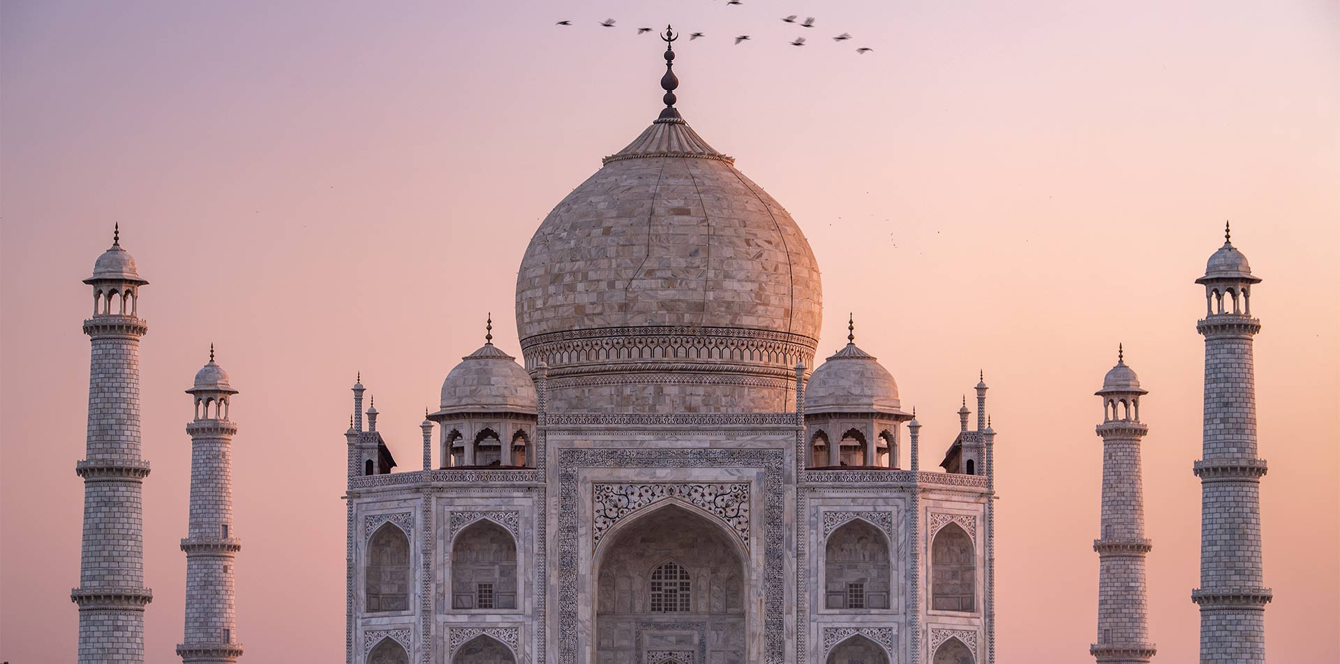 Asia India Agra view of Taj Mahal dome UNESCO world heritage site at sunset - luxury vacation destinations