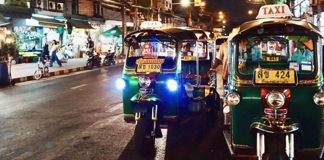 Southeast Asia Thailand Bangkok tuk tuks on local street at night - luxury vacation destinations
