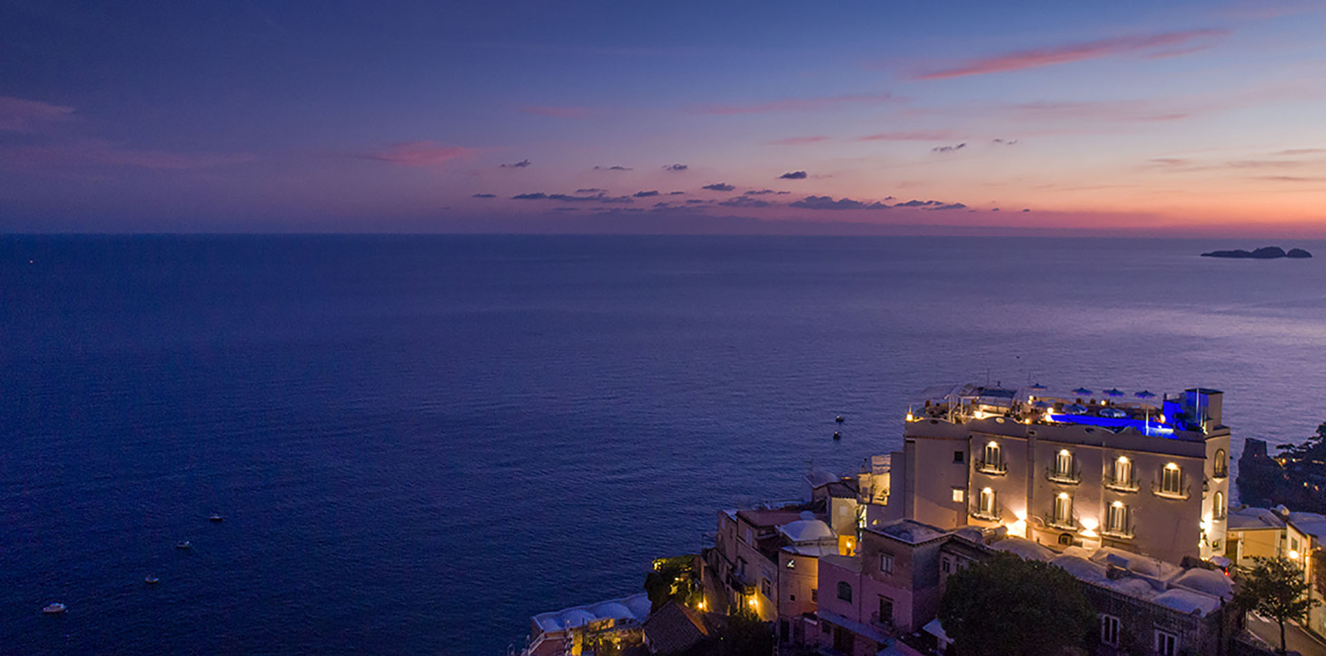 Europe Italy Amalfi Coast Salerno Positano Hotel Villa Franca exterior ocean view at sunset - luxury vacation destinations
