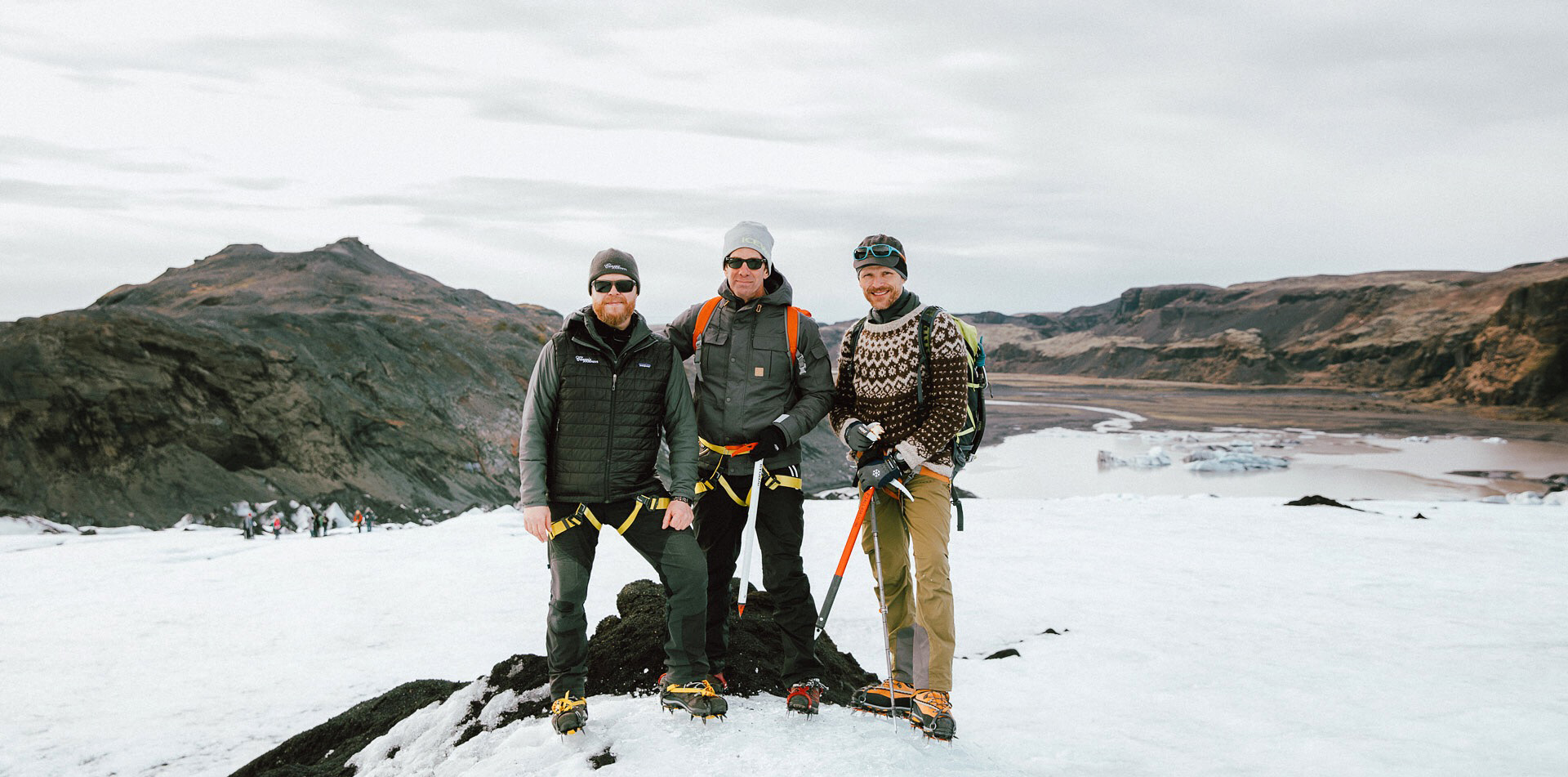Europe Iceland traveler with local Icelandic guides wearing glacier hiking gear - luxury vacation destinations