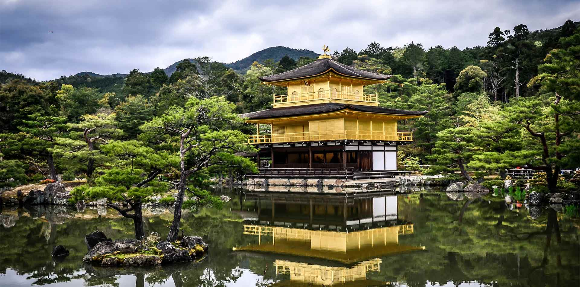 Asia Japan Kyoto Kinkaku-ji Golden Pavilion Zen Buddhist temple with beautiful gardens - luxury vacation destinations