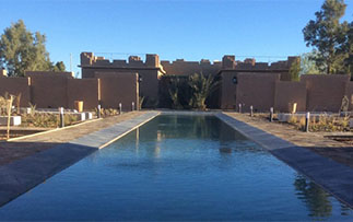 Africa Morocco Erfoud L'Hotel by Chateau de Sable beautiful pool and mud-brick exterior - luxury vacation destinations
