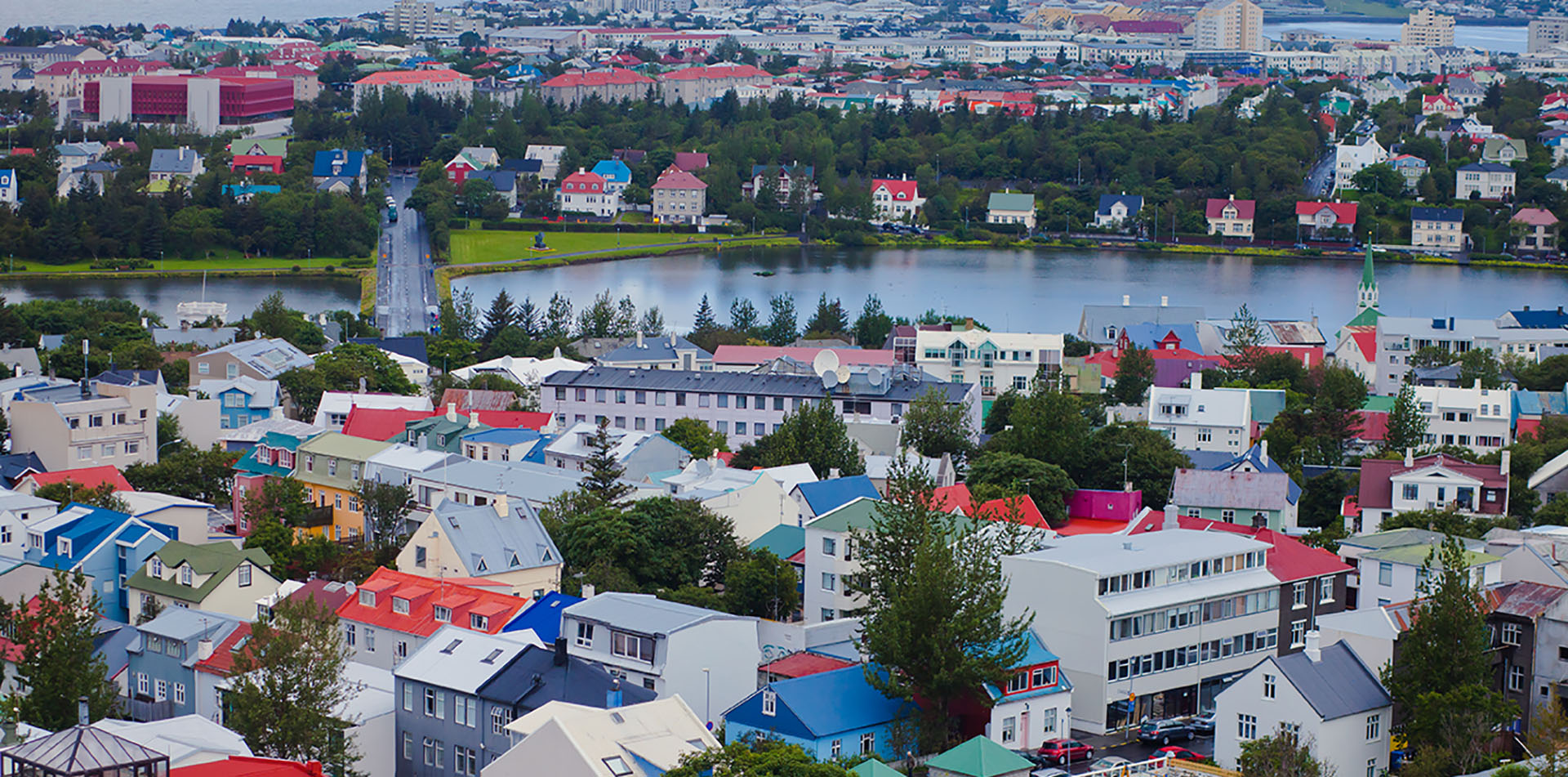 Europe Iceland Reykjavik Harbor colorful buildings along the lake in a beautiful cityscape - luxury vacation destinations