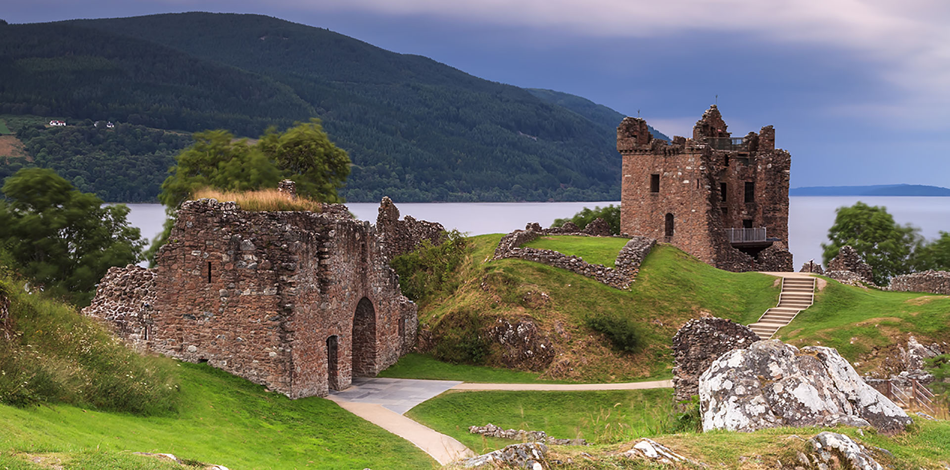 Europe United Kingdom Scotland Loch Ness Urqhart Castle ancient ruins scenic mountains - luxury vacation destinations