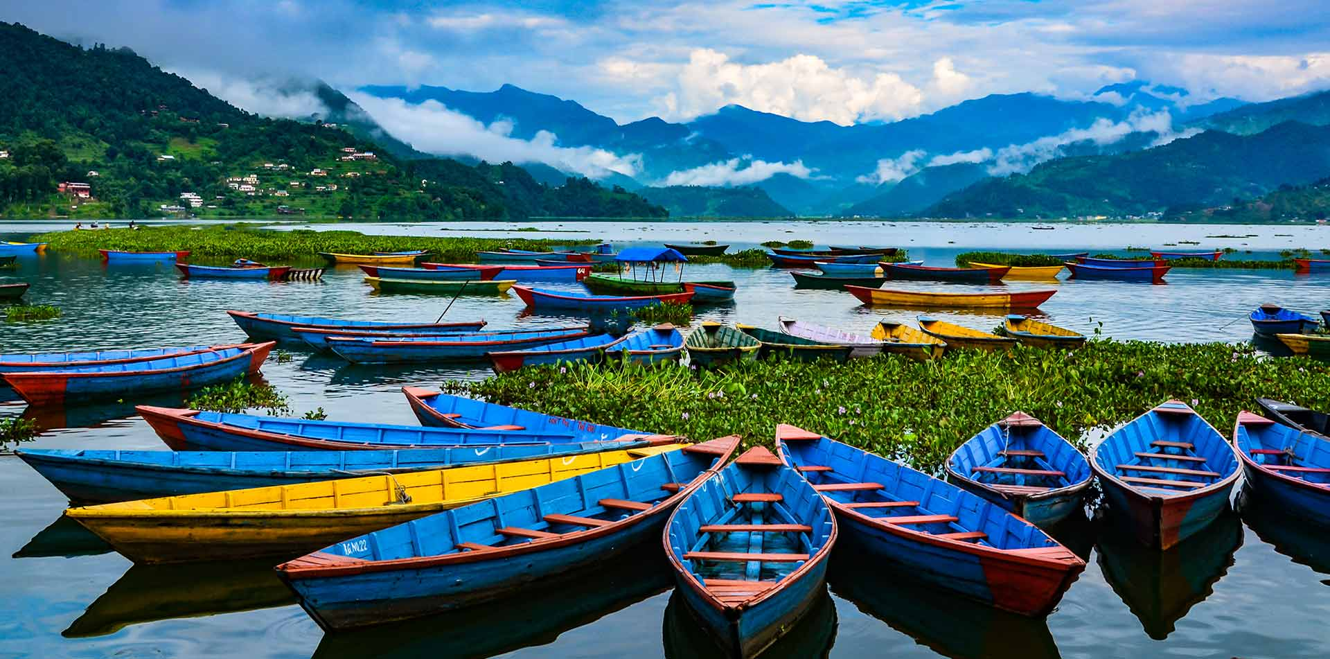 Colorful row boats docked on lake