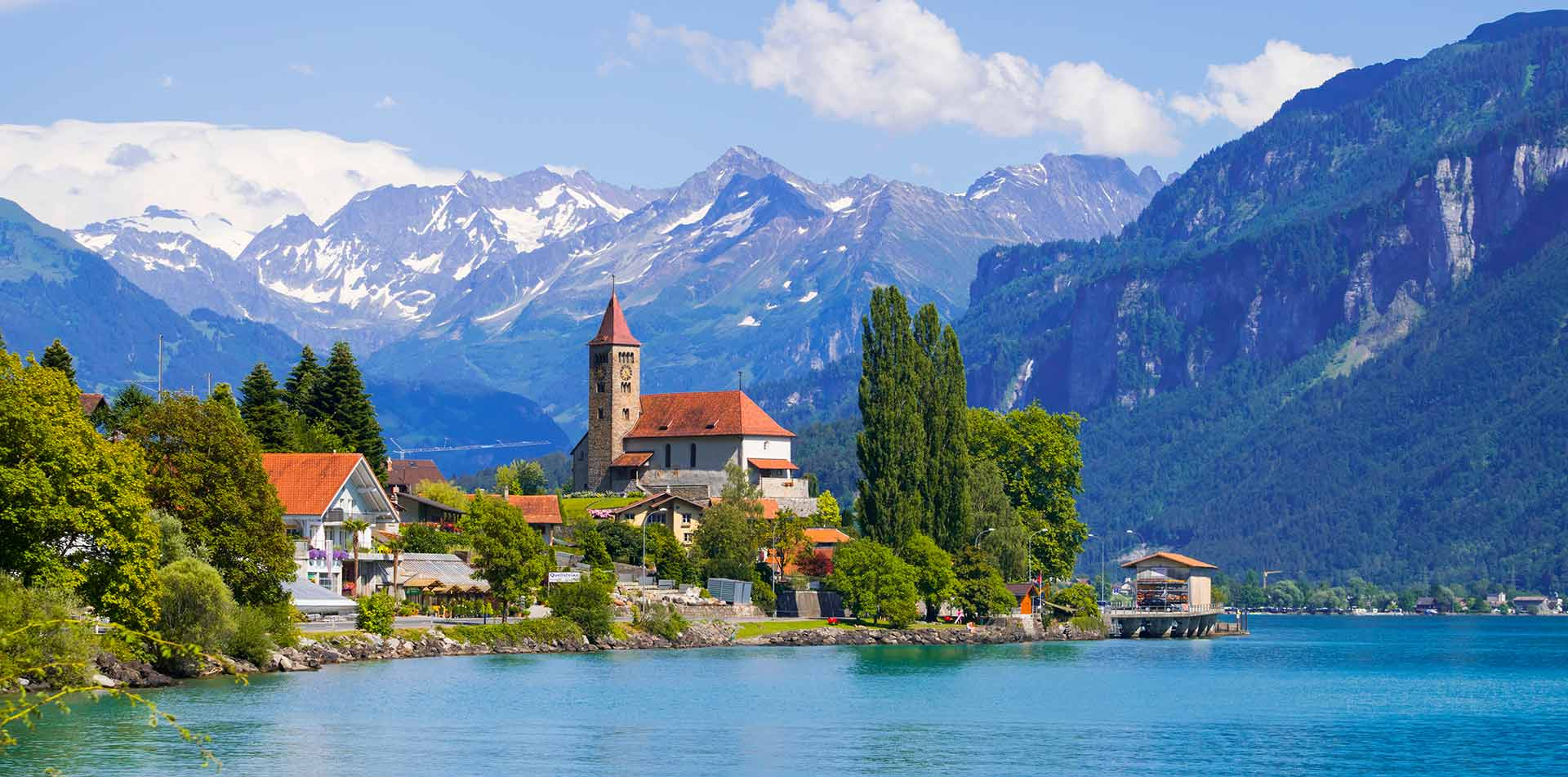 Panoramic view of Brienz town on lake, Swiss Alps