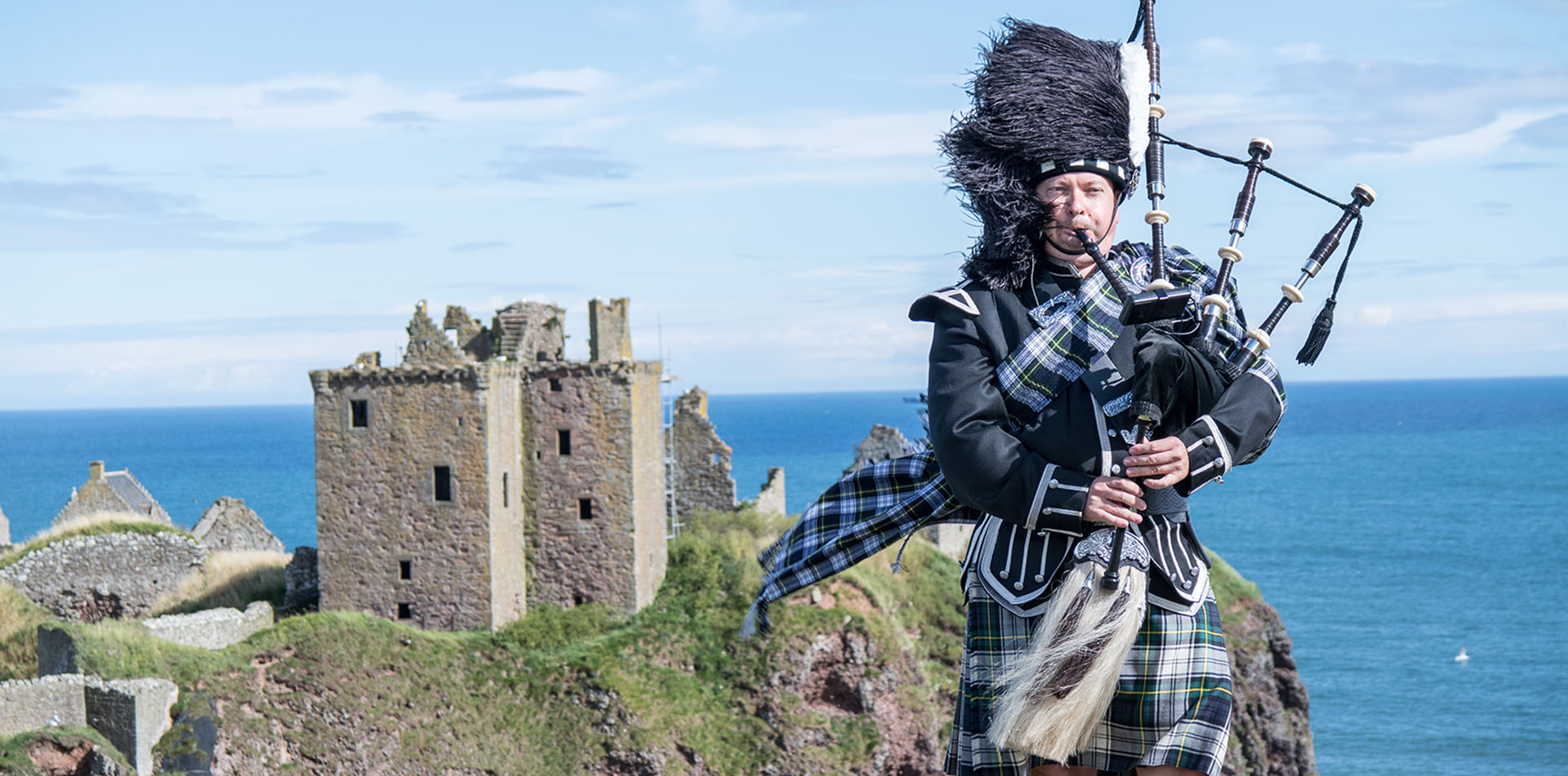 Scottish Bagpiper at Urquhart Castle, Scotland