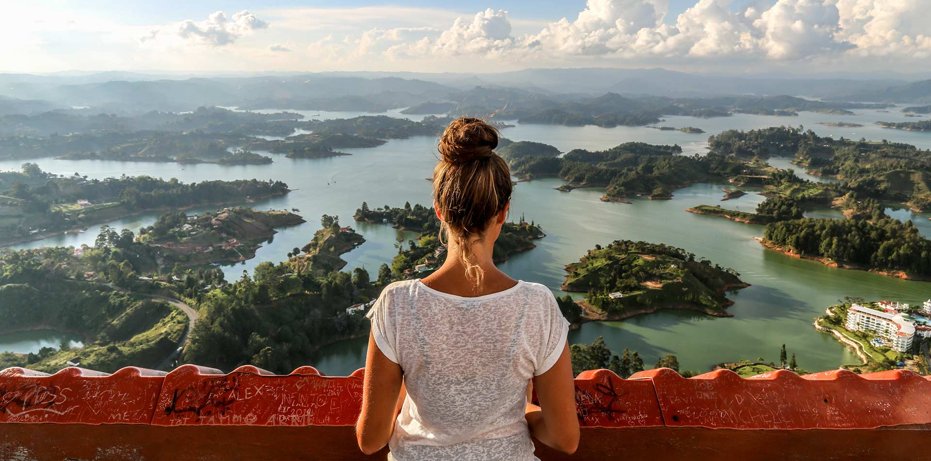 South America Colombia woman overlooking Guatape from scenic viewpoint - luxury vacation destinations