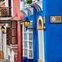 South America Colombia bright blue building Calle Stuart on local Cartagena street - luxury vacation destinations
