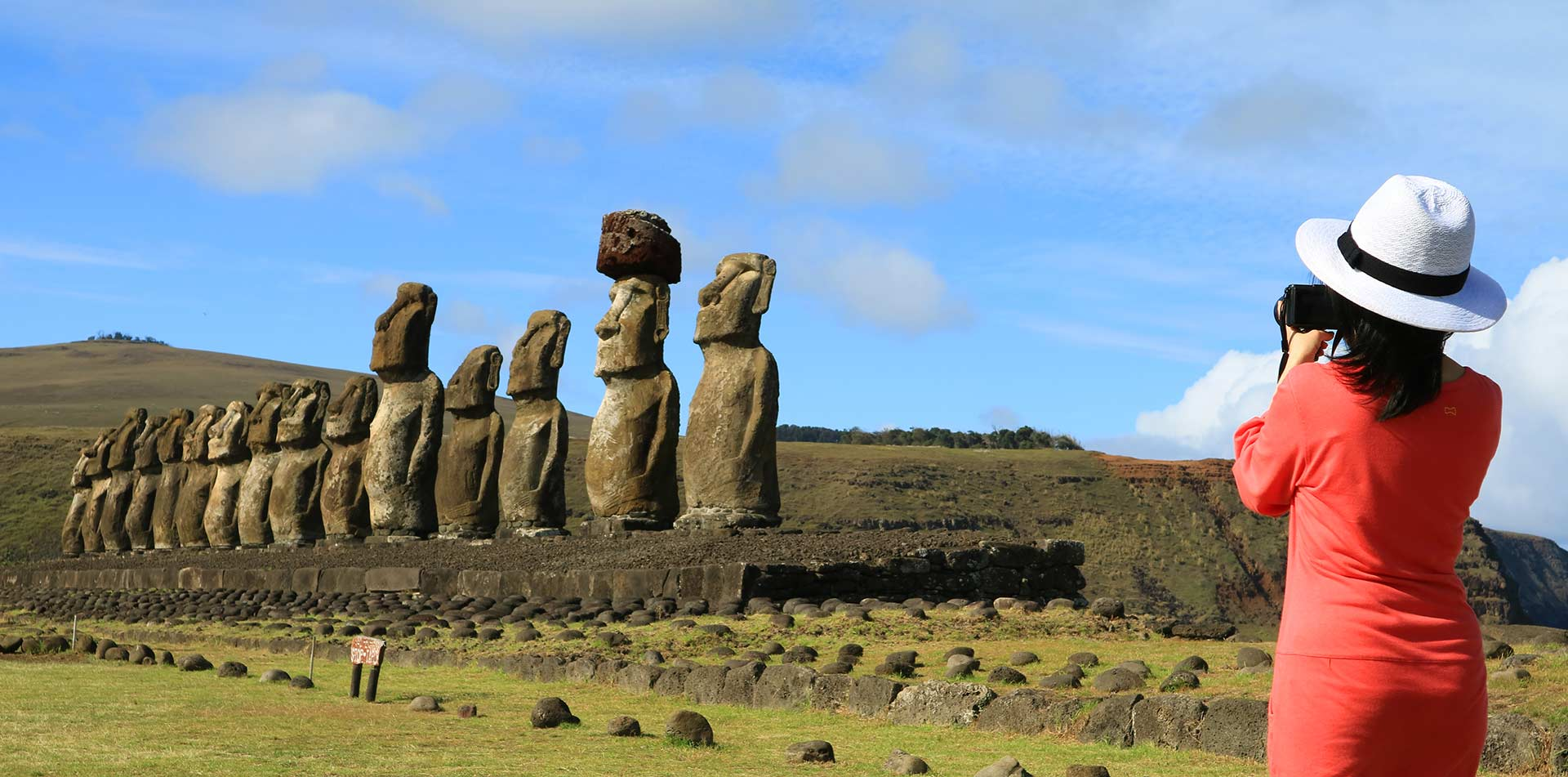 South America Chile Woman Taking Pictures Famous Moai Image - luxury vacation destination