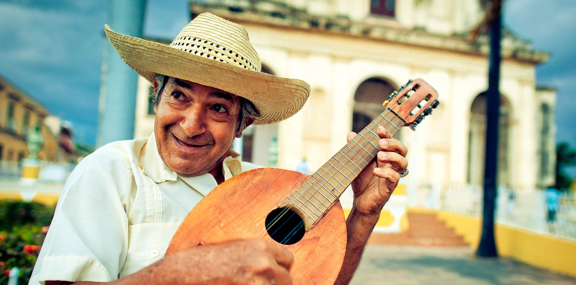 North America Caribbean Cuba Havana music art man hat mandolin local smile happy - luxury vacation destinations