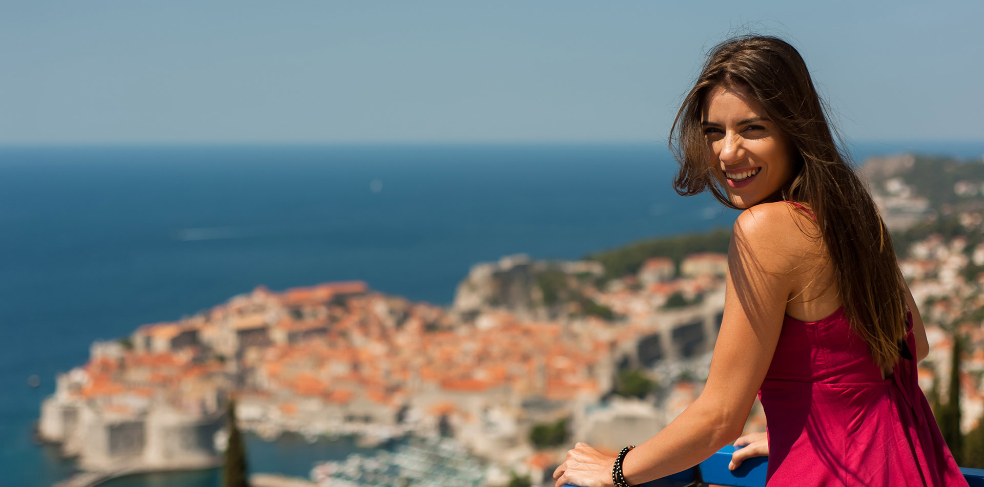 Europe Croatia Dubrovnik scenic Dalmatian Coast happy young woman smiling beautiful cityscape - luxury vacation destinations