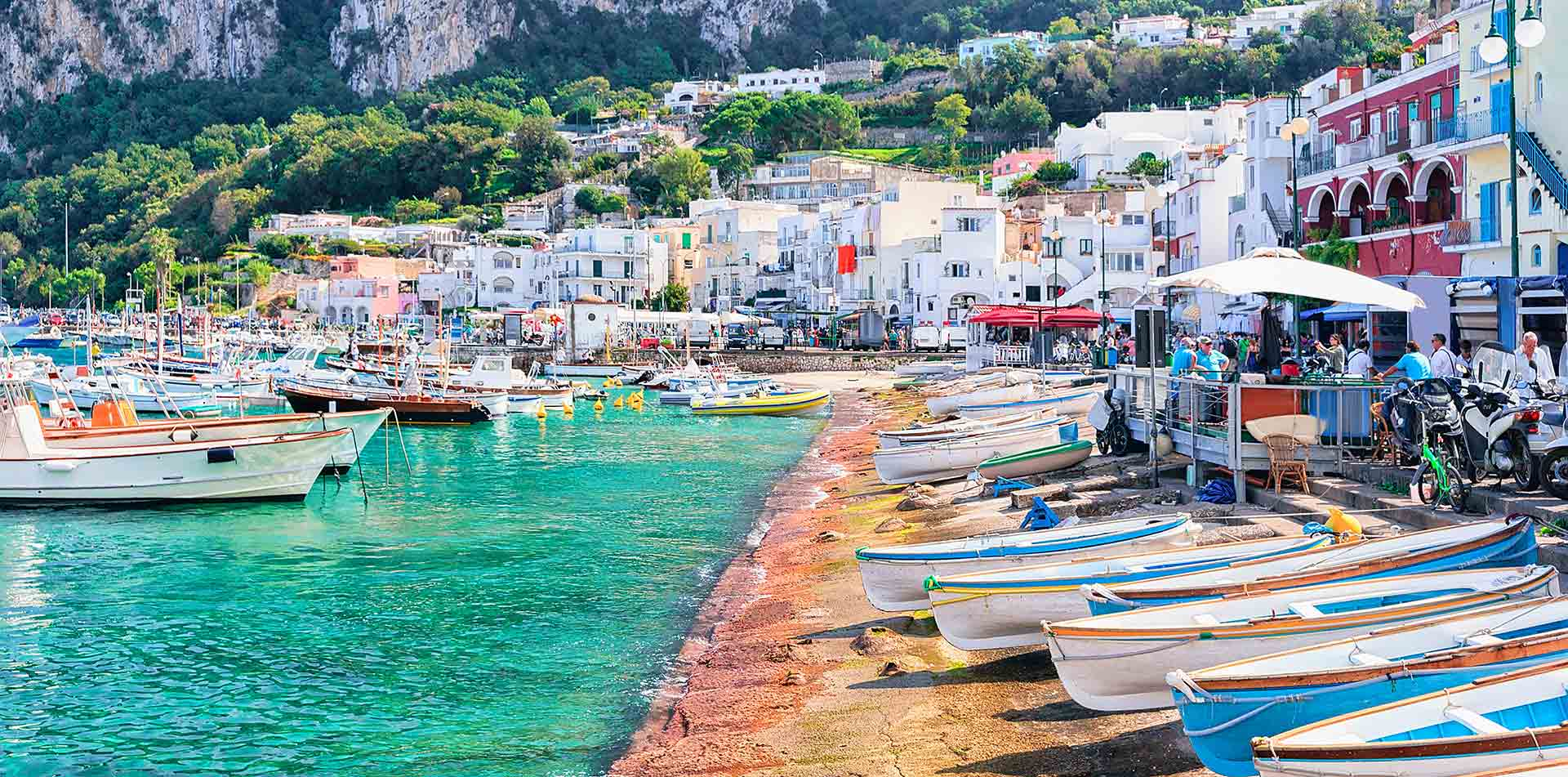Europe Italy Amalfi Coast Capri marina grande embankment with boats on shore with blue water - luxury vacation destinations