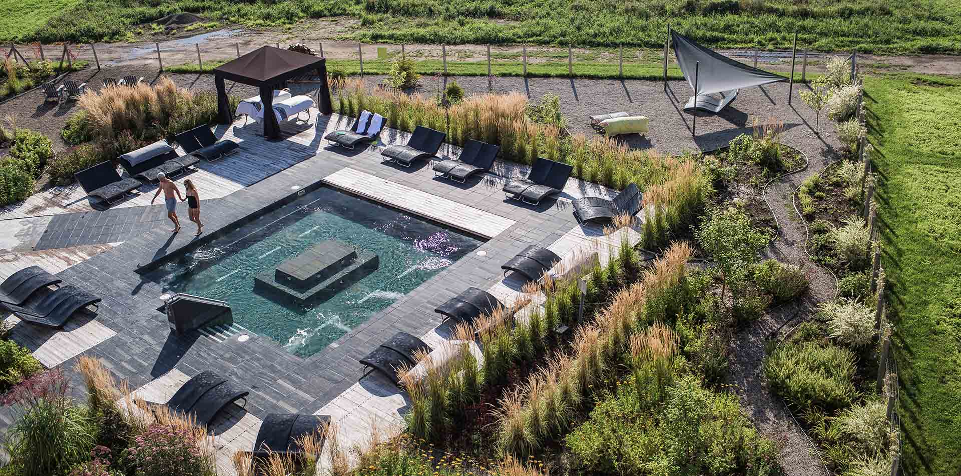 North America Canada Quebec Charlevoix Spa Nordique Le Germain outdoor pool lounge couple - luxury vacation destinations