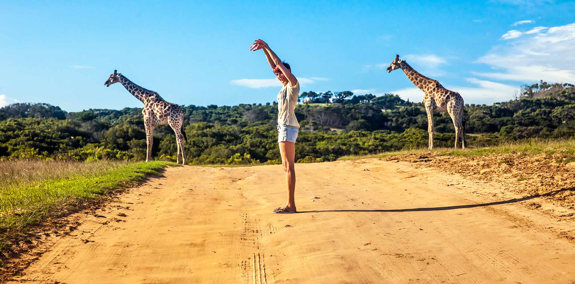 woman mimicking giraffes