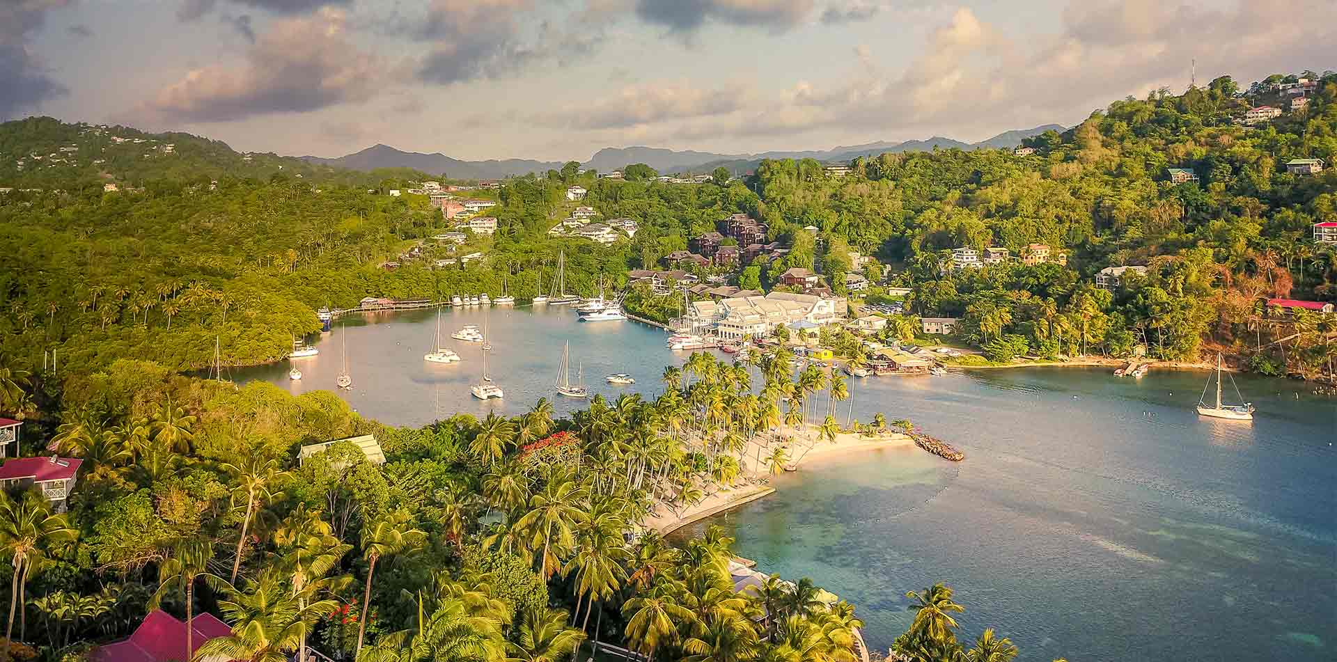 Latin America Caribbean West Indies St. Saint Lucia Sailing sail boats in Marigot Bay harbor - luxury vacation destinations