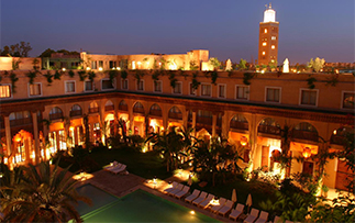 Africa Morocco Marrakesh Les Jardins De La Koutoubia beautiful bright exterior pool at night - luxury vacation destinations