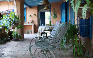 North America Caribbean Cuba Trinidad La Casona La Empresa hotel patio rocking chair relax - luxury vacation destinations