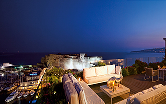 Europe Italy Amalfi Coast Naples Grand Hotel Vesuvio Caruso Roof Garden restaurant patio night - luxury vacation destinations