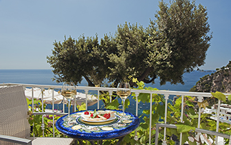 Europe Italy Amalfi Coast Salerno Positano Hotel Villa Gabrisa outdoor patio lunch olive tree - luxury vacation destinations