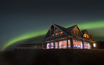 Europe South Iceland Hella Hotel Ranga at night under northern lights aurora borealis - luxury vacation destinations
