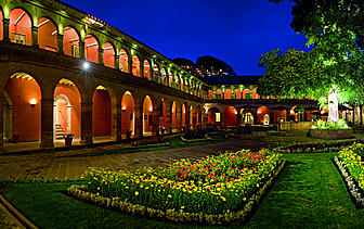 South America Peru Cusco historic Belmond Hotel Monasterio bright courtyard colorful flowers - luxury vacation destinations