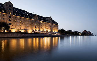 Europe Scandinavia Denmark Copenhagen Admiral hotel exterior view at night from waterfront - luxury vacation destinations