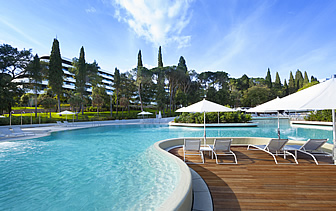 Europe Croatia Hotel Lone Rovinj beautiful outdoor pool relaxing deck lounge chairs - luxury vacation destinations