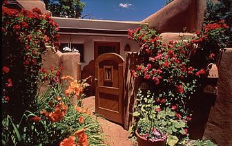 North America United States New Mexico Santa Fe Inn on the Alameda entrance colorful flowers - luxury vacation destinations