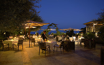 Europe Italy Sicily Taormina Grand Hotel San Pietro outdoor courtyard with ocean view at night - luxury vacation destinations