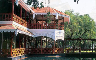 Asia Myanmar Belmond Governor's Yangon Residence ornate carved teak exterior relaxing pool - luxury vacation destinations