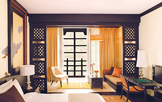 Asia Bhutan Paro Thimphu Taj Tashi guest bedroom with balcony - luxury vacation destinations