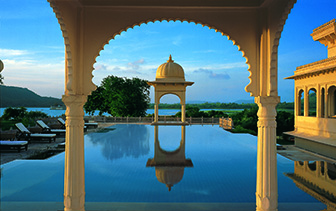 Asia India The Oberoi Udaivilas Udaipur outdoor pool through archway - luxury vacation destinations